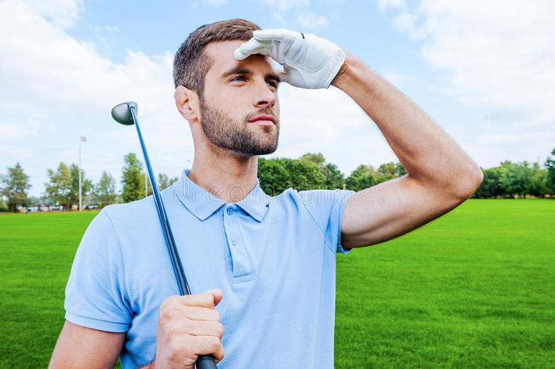 Confident golfer. stock photography