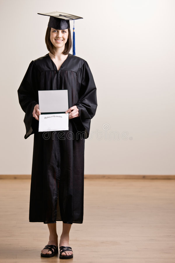 Confident Graduating Student Wearing Cap And Gown Stock Photo ...