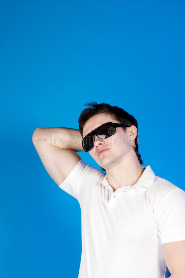 Confident guy with the glasses in the studio