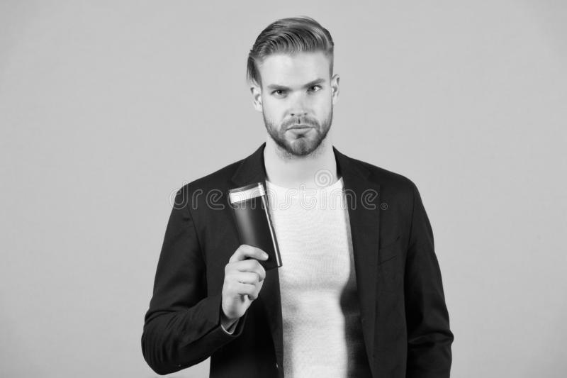Confident in hair care product. Man stylish hairstyle holds bottle hygienic product grey background. Switch matte. Products if thinning. Men hair thins out stock photography