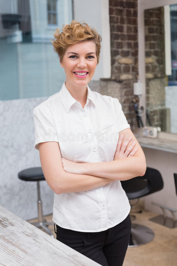 Confident hairdresser smiling at camera royalty free stock image