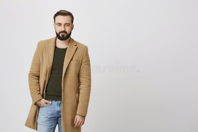 Confident handsome man with a beard and moustache holding his hand in a pocket over white background. Bachelor dressed stock photos