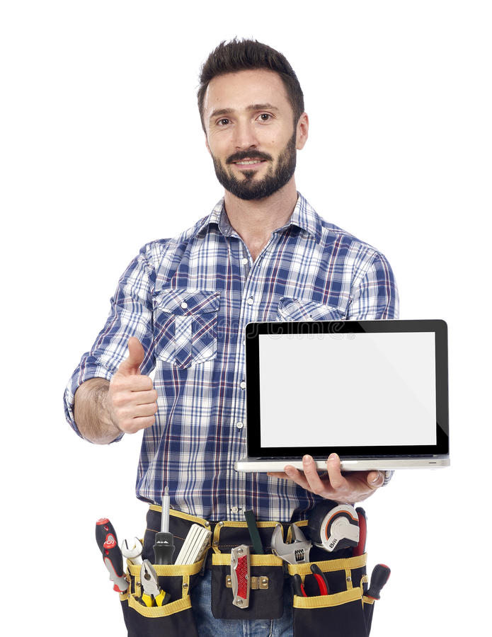 Confident handyman with laptop. Carpenter with laptop showing ok sign, white background stock image