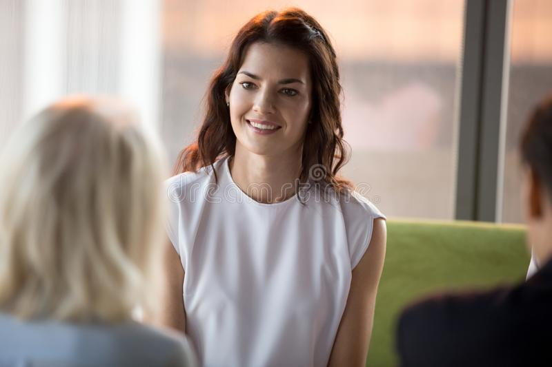 Confident happy applicant smiling looking at hr during job interview. Confident happy millennial seeker applicant smiling looking at hr during job interview royalty free stock photos