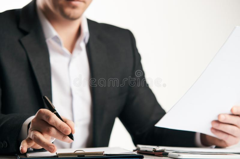 Confident happy businessman signing contract stock image