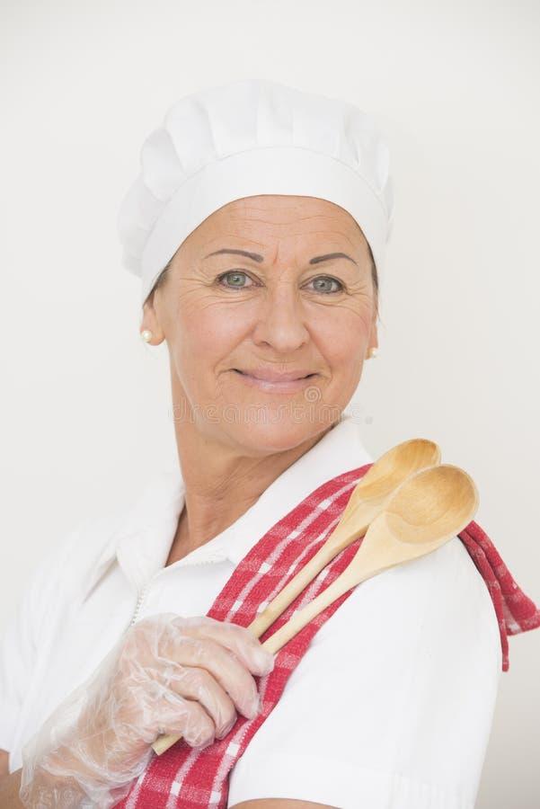 Confident happy female chef portrait stock image