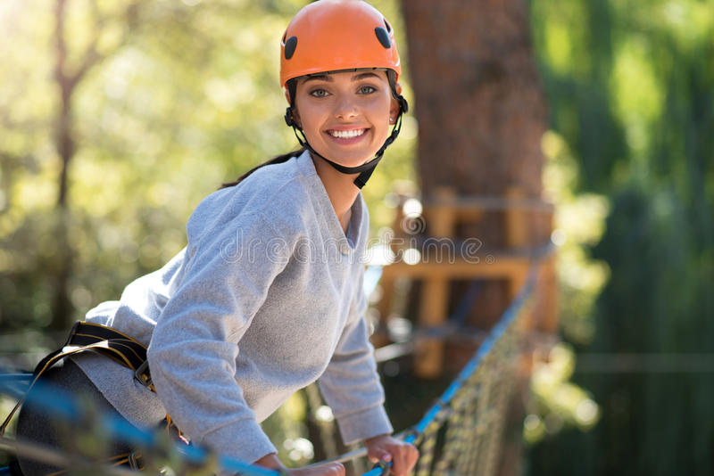 Confident happy woman leaning forwards. Joy and happiness. Joyful pretty slim woman leaning forwards and smiling while looking at you royalty free stock image