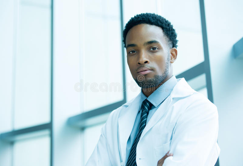 Confident heatlhcare professional. Closeup portrait friendly, kind confident male doctor, arms crossed, healthcare professional with a white coat, isolated stock images