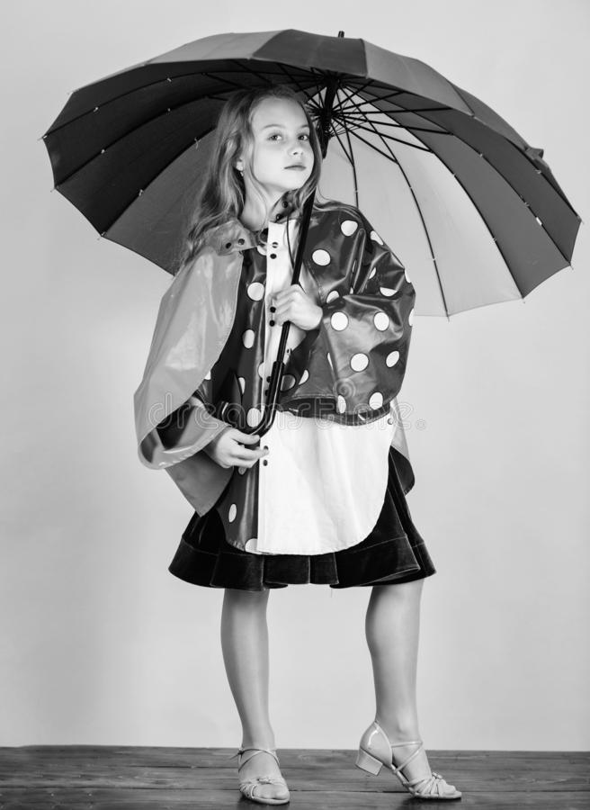 Confident in her fall garments. Waterproof accessories manufacture. Kid girl happy hold colorful umbrella wear stock image