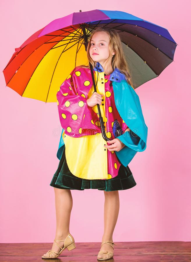 Confident in her fall garments. Waterproof accessories manufacture. Kid girl happy hold colorful umbrella wear royalty free stock photography