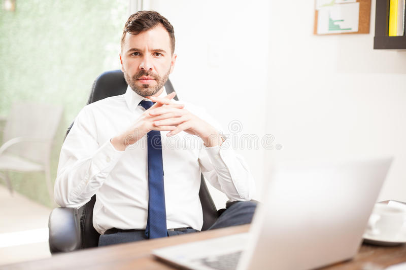 Confident Hispanic CEO in his office royalty free stock photos