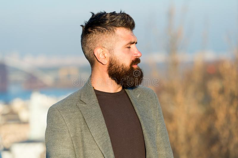 Confident individual. Brutal hipster. Caucasian hipster with thick beard hair. Bearded man in trendy hipster style royalty free stock image