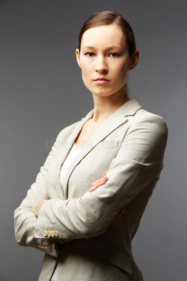 Confident leader. Portrait of a smart businesswoman looking at camera royalty free stock image