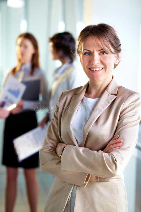 Confident leader. Image of successful middle aged businesswoman looking at camera royalty free stock image