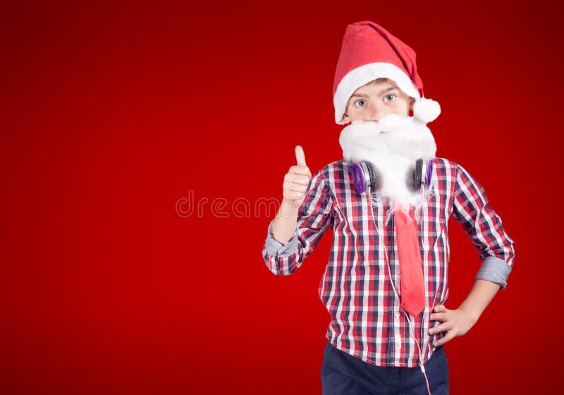 Confident little Santa Claus royalty free stock image