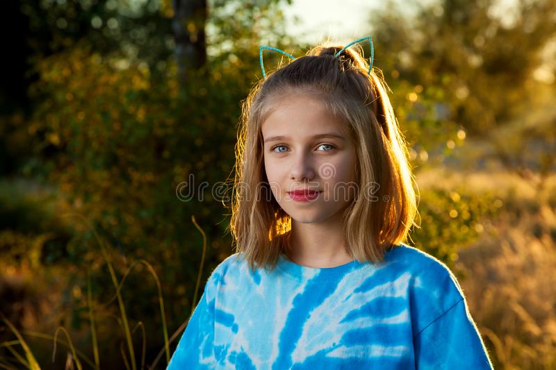 Confident Looking Backlit Young Girl Close Mouth Smile and Cat E stock photo
