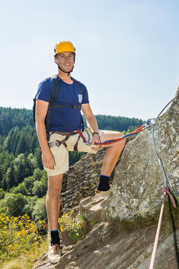Download Confident Male Climber Standing On Rock Stock Image - Image: 33671591