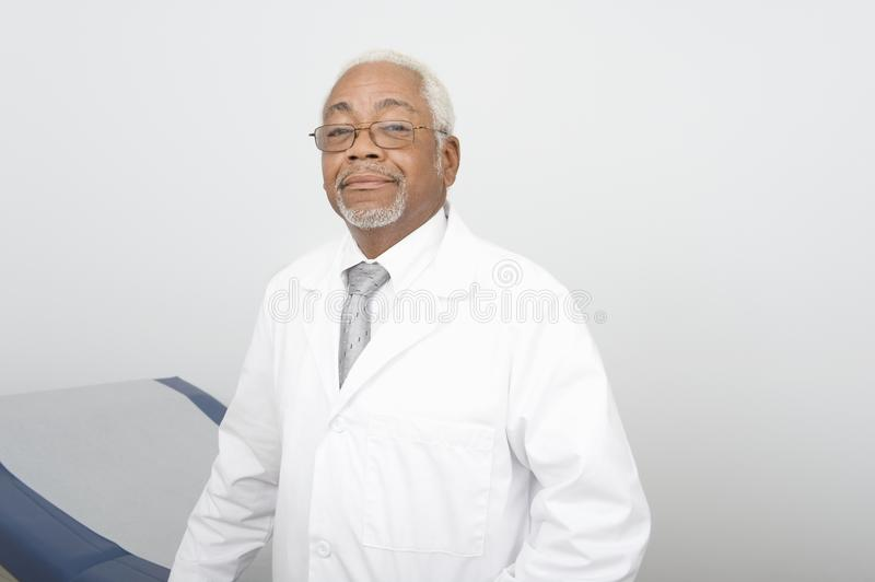 Confident Male Doctor At Clinic. Portrait of an African American confident male doctor standing at clinic royalty free stock photography