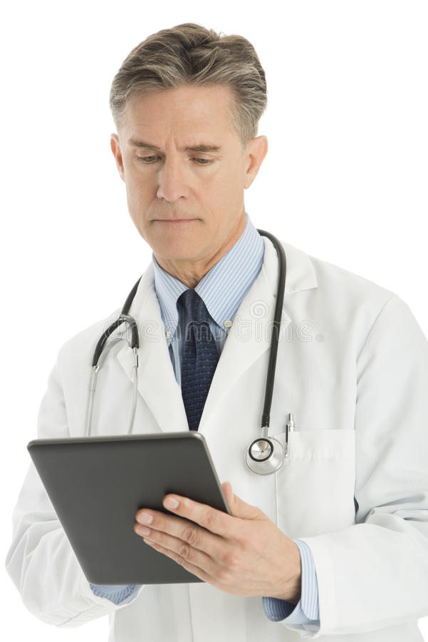 Confident Male Doctor Using Digital Tablet royalty free stock image