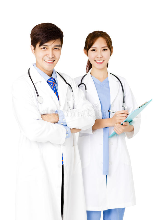 Confident male and female doctors standing together royalty free stock photo