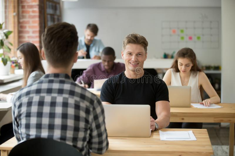 Confident male freelancer smiling at camera stock photo