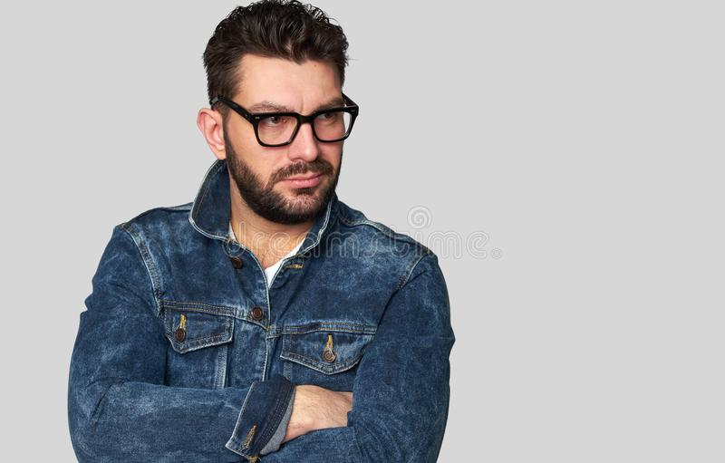 Confident male model has black beard and mustache stock images