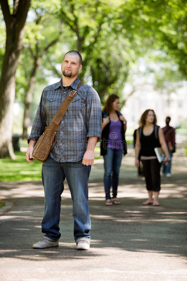 Confident Male Student On Standing Campus Road royalty free stock photo