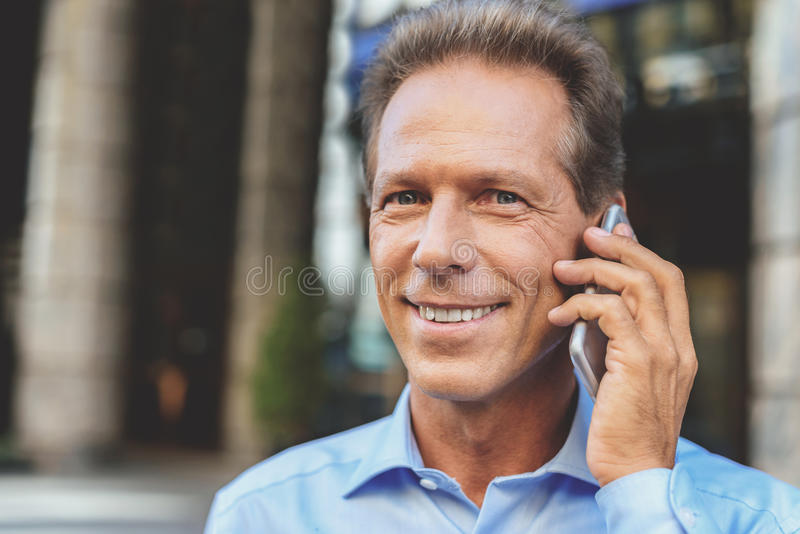 Confident man communicating on smartphone royalty free stock photos
