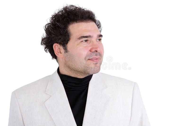 Confident man looking off into the distance. Slightly grinning confident man with curly hair and stubble wearing white jacket and polo-neck shirt looking off royalty free stock photos