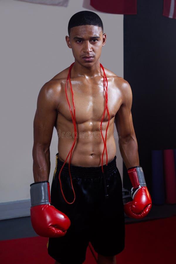 Confident man standing in fitness studio stock images