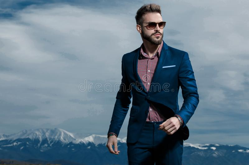 Confident man stepping and looking to the side royalty free stock photography