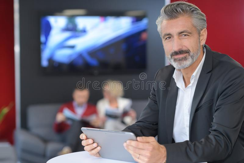 Confident man successful entrepreneur reading monthly report royalty free stock images