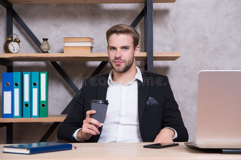 Confident man use laptop. Boss workplace. Handsome man in business office. Inspired with cup of fresh coffee. Ceo head royalty free stock image