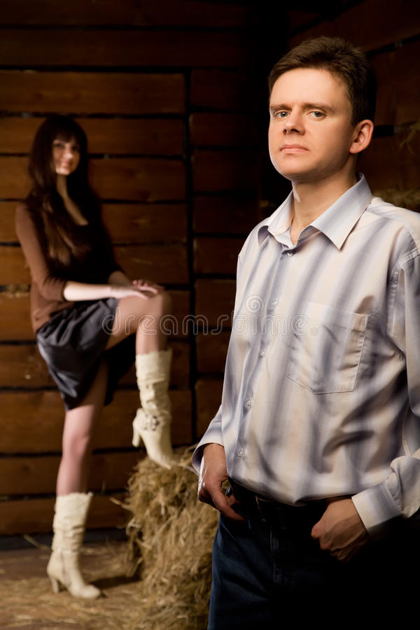 Download Confident Man And Young Woman In Wooden Log Hut Stock Photos - Image: 14577793
