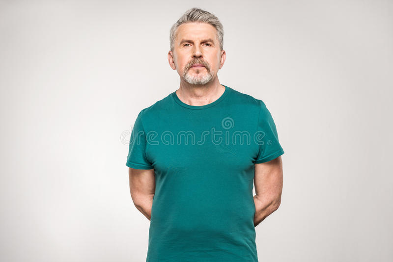 Confident mature fitness manager in sportswear standing stock image