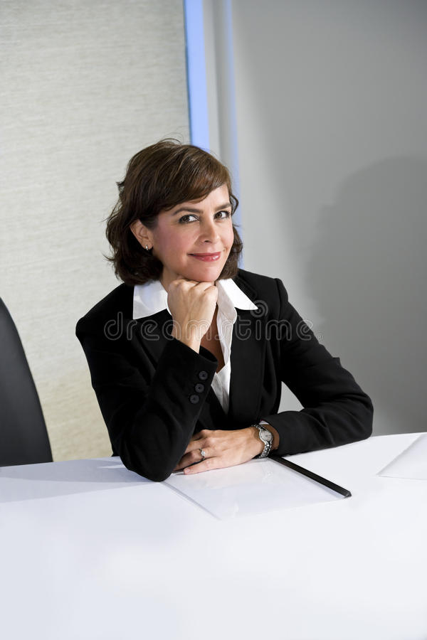 Confident mid-adult businesswoman royalty free stock image
