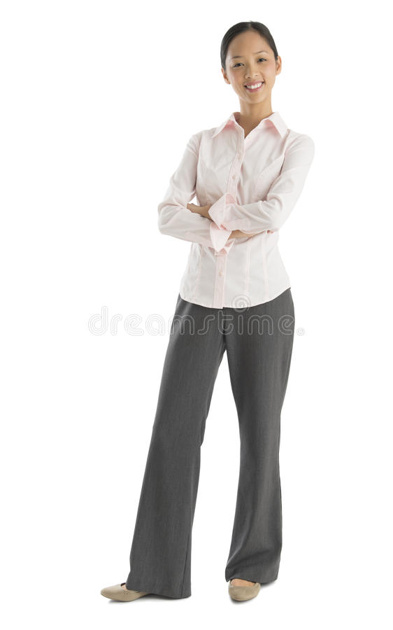Confident Mid Adult Businesswoman Standing Arms Crossed. Full length portrait of confident mid adult businesswoman standing arms crossed against white background stock photography