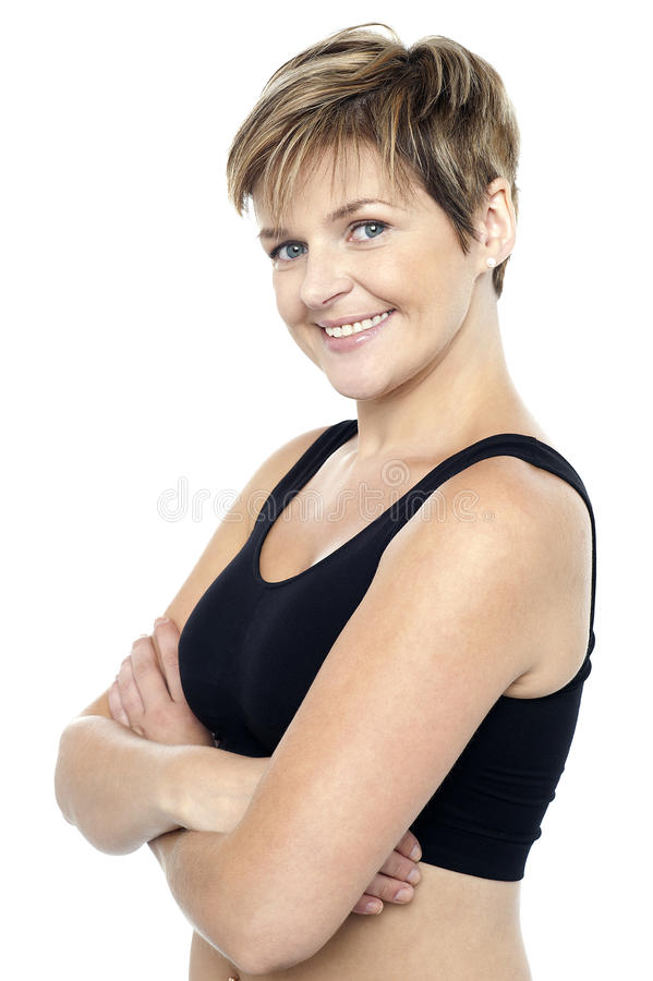 Confident middle-aged female instructor stock photo