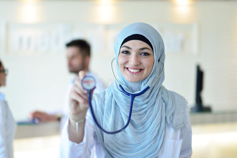Confident Muslim medical student pose at hospital stock image