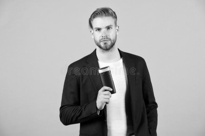 Always confident in my shampoo. Man stylish hairstyle holds bottle matte product grey background. Make thicker use matte. Styling paste or clay. Matte product stock image