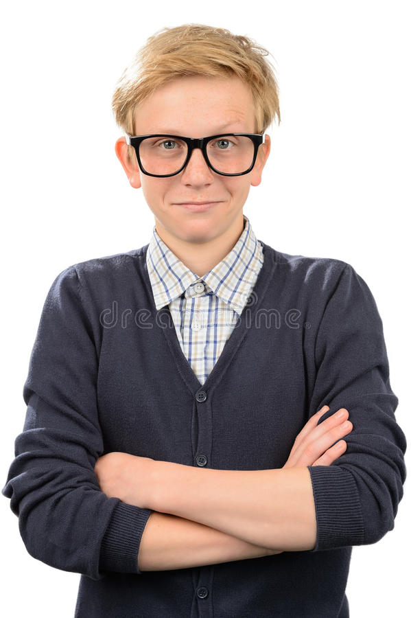 Confident nerd boy wearing geek glasses. Standing against white background stock photography