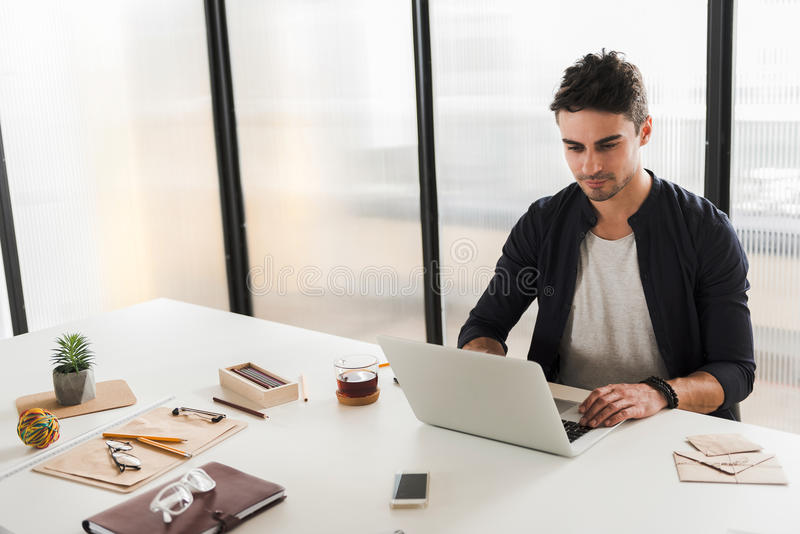 Confident office worker doing his job stock photography
