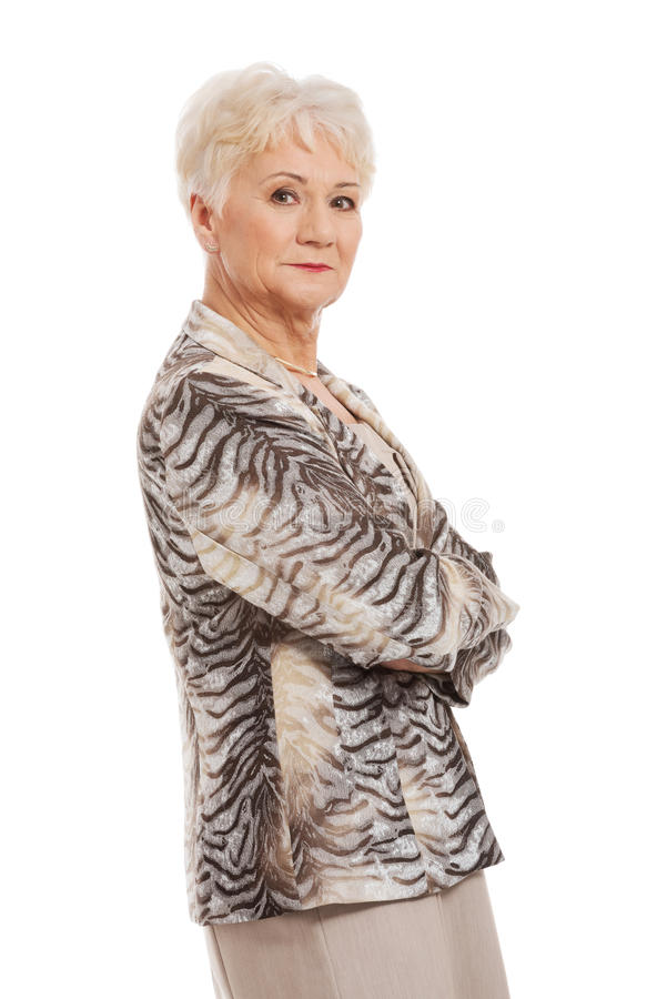 Confident old woman with folded arms royalty free stock photos