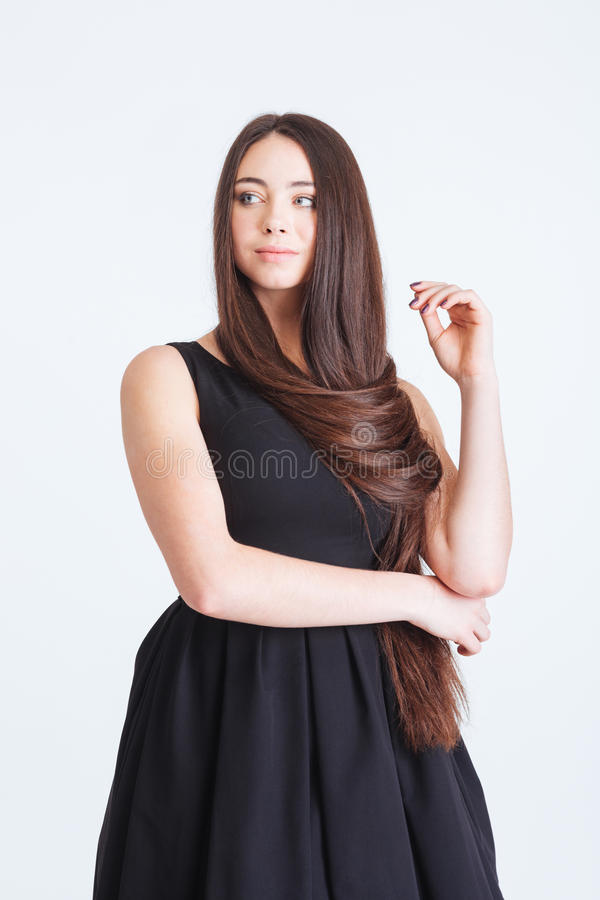 Confident pensive young woman with beautiful long dark hair stock photos