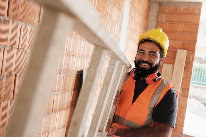Portrait Of Happy Hispanic Worker Smiling In Construction Site stock images