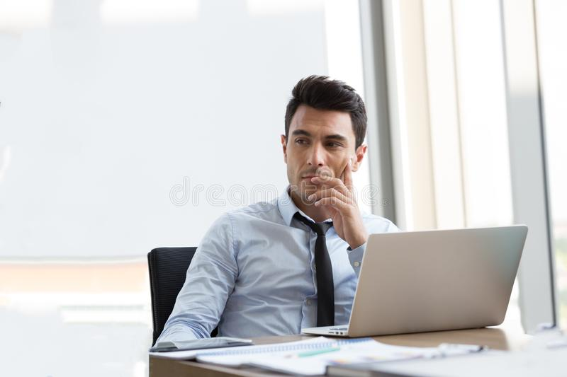 Confident professional businessman executive thinks developing a new idea stock photography