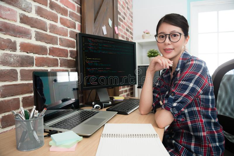 Confident professional female programmer worker royalty free stock photo