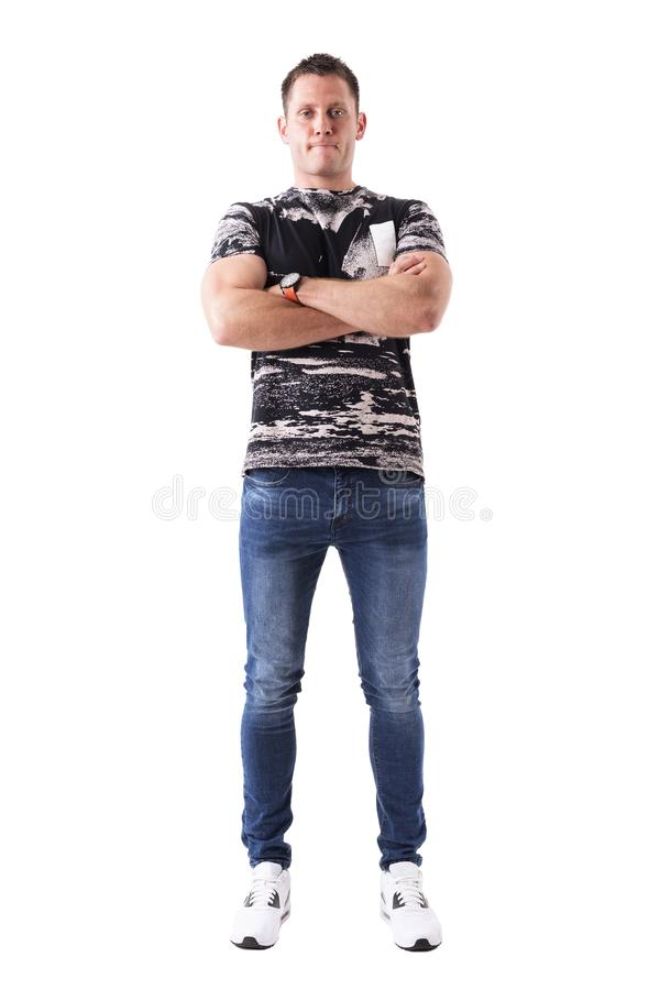 Confident proud casual young adult man with crossed arms looking at camera. stock photo