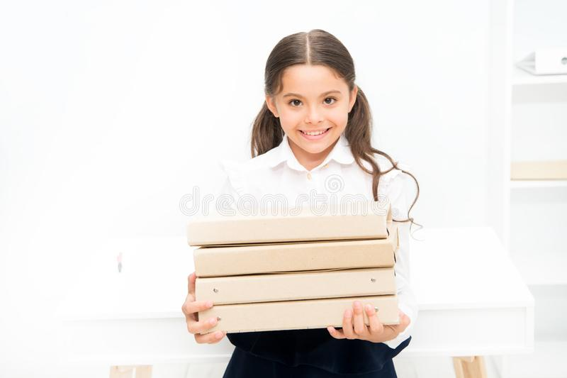 Confident pupil. Towards knowledge. small girl in school uniform. lot of homework. Get information. kid learn and study. Hard. back to school. happy girl with royalty free stock image