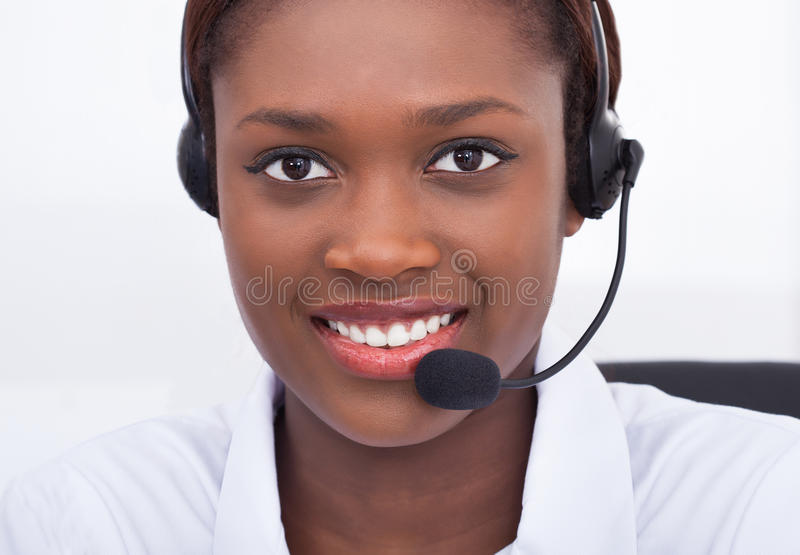 Confident receptionist using headset in hospital. Close-up portrait of confident receptionist using headset in hospital stock photos